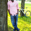 Young black guy in park — Stock Photo #26309749