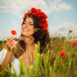 Beautiful young girl in flower field — Stock Photo
