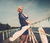 Fashionable woman on an old pier — Stock Photo