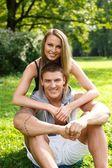 Beautiful sporty couple outdoors — Stock Photo