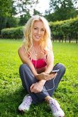 Blond sporty girl outdoors — Stock Photo