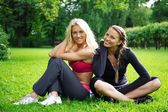Two sporty girls outdoors — Stock Photo