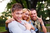 Group of stylish friends in a park on summer day — Stock Photo