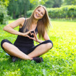 Sporty girl showing heart sign with her hands — Stock Photo