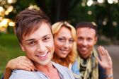 Friends in a park on sunny day — Stock Photo