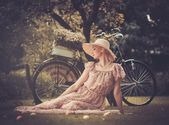 Retro woman with bicycle — Stock Photo