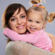 Mother hugs her little daughter — Stock Photo #30898201