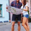 Tourist couple with map — Stock Photo