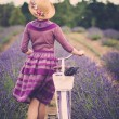 Woman with retro bicycle in lavender field — Stock Photo