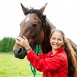 Girl with horse — Stock Photo #32142269