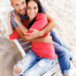 Happy smiling middle-aged couple on a beach — Foto Stock