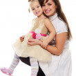 Happy smiling young mother holding her little daughter — Stock Photo #32304667