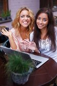 Two beautiful girls with laptop — Stock Photo