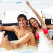 Young couple relaxing in a jacuzzi — Stock Photo