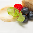 Piece of cake with custard and fruits — ストック写真