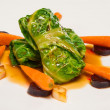Stuffed cabbage roll with carrots and sauce  — ストック写真