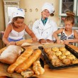 Happy children cooking homemade pastry — Stock Photo
