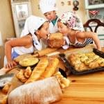 Happy children cooking homemade pastry — Stock Photo
