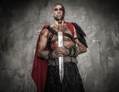 Gladiator with sword — Stock Photo