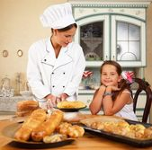 Mother cook with her daughter cooking homemade pastry — Stock Photo