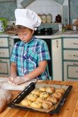 Young cook boy making homemade pastry — Stock Photo