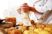 Cook hands preparing dough for homemade pastry — Stock Photo