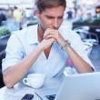 Young man with laptop — Stock Photo #33349879