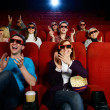 Group of people in 3D glasses watching movie in cinema — Stock Photo #33868171