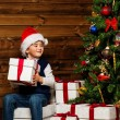 LIttle boy opening gift box under christmas tree — Stock fotografie
