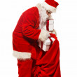 Santa Claus with christmas sack and gift boxes isolated on white background — Stock Photo #33868903