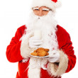Santa Claus with oatmeal cookies and glass of milk isolated on white background — Stock Photo #33869125