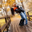 Happy middle-aged couple kissing outdoors on beautiful autumn day — Stock Photo #33869137