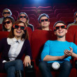 Group of people in 3D glasses watching movie in cinema — Foto de Stock