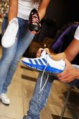 People choosing sports footwear in sport outlet — Stok fotoğraf