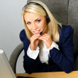 Beautiful blond help desk office support woman with headset — Stock Photo #36291369
