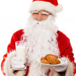 Santa Claus with oatmeal cookies and glass of milk isolated on white background — Stock Photo #36291371