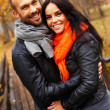 Happy middle-aged couple outdoors on beautiful autumn day — Stockfoto
