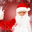 Santa Claus showing with gestures something — Stock Photo