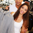 Beautiful young couple in s sport outlet — Stock Photo