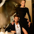 Sexy well-dressed young couple in luxury restaurant interior — Stock Photo #36293339