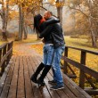 Happy middle-aged couple kissing outdoors on beautiful autumn day — Stock Photo #36293353