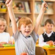 Funny redhead boy in school — Stock Photo
