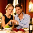 Young beautiful couple in love in a luxury restaurant — Stock Photo