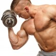 Handsome young muscular man exercising with dumbbells — Stock Photo