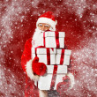 Santa Claus with gift boxes in snowstorm — Stock Photo #36293629