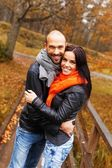Happy middle-aged couple outdoors on beautiful autumn day — Stock Photo