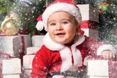 Little boy in Santa hat with a gift boxes — ストック写真