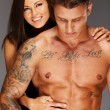 Young woman embracing man with naked muscular torso — Foto de Stock