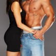 Young woman embracing man with naked muscular torso — Stock Photo #36566915