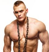 Handsome young muscular man with chain — Stock Photo